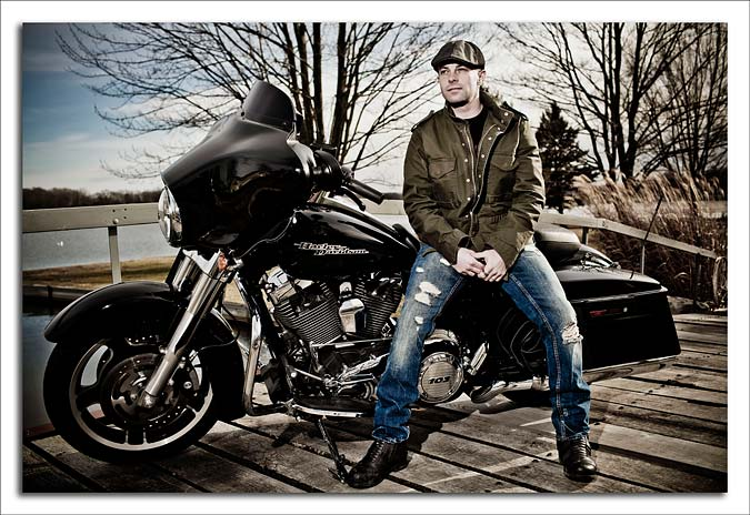 Photo of Daniel G. McNulty with his Black Harley Davidson Street Glide