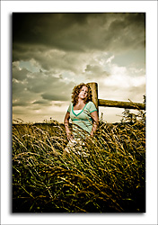 dgmphotography Investment Page Image 6 HS Senior Girl in a wheatfield with stormy skies